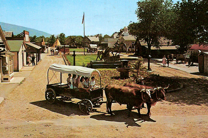 Ox-Drawn Wagon in operation at Pioneer Village in Salt Lake City in a postcard from around 1969.